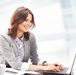 Woman on computer happy